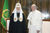 Pope Francis and the head of the Russian Orthodox Church Patriarch  Kirill pose for photos before their meeting at the Jose Marti aiport in Havana, Cuba, Friday, Feb. 12, 2016. This is the first-ever papal meeting with the head of the Russian Orthodox Church, a historic development in the 1,000-year schism within Christianity. (Ismael Francisco/Cubadebate via AP)